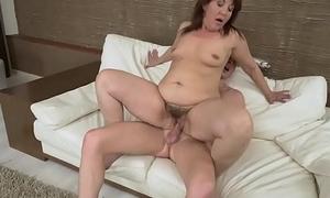 Heeled granny riding cock